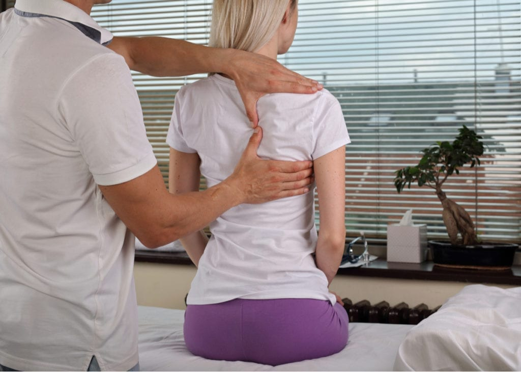 chiropractic care on back of female patient