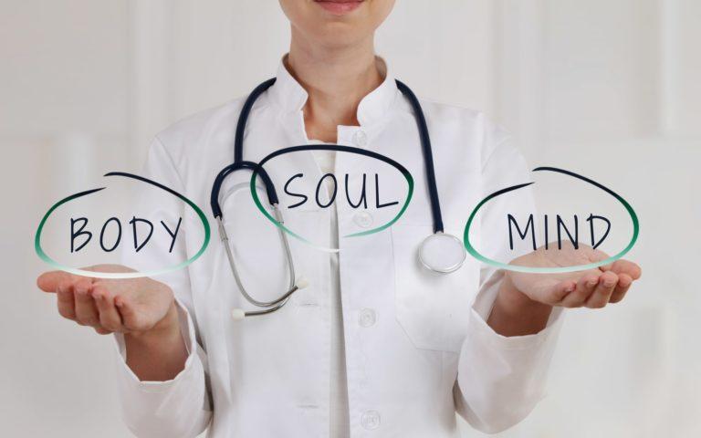 Doctor holding words Body/Mind/Soul