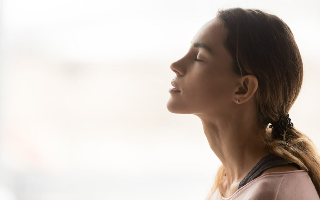 Woman self-soothing and easing stress